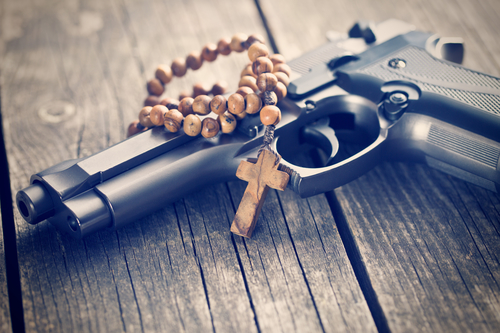 rosary beads and gun